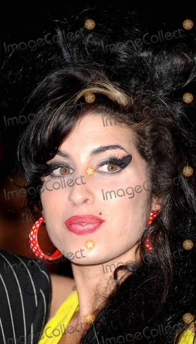 Amy Winehouse Photo - London UK Amy Winehouse at the 2007 Brit Awards held at Earls Court in London  14th February 2007Eric BestLandmark Media