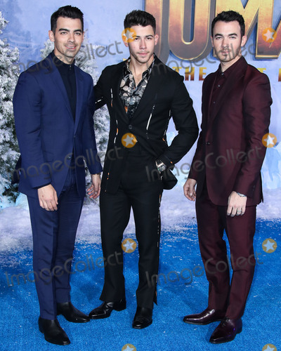 Joe Corr Photo - HOLLYWOOD LOS ANGELES CALIFORNIA USA - DECEMBER 09 Joe Jonas Nick Jonas and Kevin Jonas of Jonas Brothers arrive at the World Premiere Of Columbia Pictures Jumanji The Next Level held at the TCL Chinese Theatre IMAX on December 9 2019 in Hollywood Los Angeles California United States (Photo by Xavier CollinImage Press Agency)