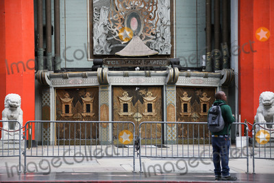 TCL Chinese Theatre Photo - HOLLYWOOD LOS ANGELES CALIFORNIA USA - MARCH 21 TCL Chinese Theatre IMAX formerly the Graumans Chinese Theatre temporarily closed due to the coronavirus two days after the Safer at Home order issued by both Los Angeles Mayor Eric Garcetti at the county level and California Governor Gavin Newsom at the state level on Thursday March 19 2020 which will stay in effect until at least April 19 2020 amid the Coronavirus COVID-19 pandemic March 21 2020 in Hollywood Los Angeles California United States (Photo by Xavier CollinImage Press Agency)