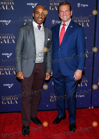 Joe Corr Photo - MANHATTAN NEW YORK CITY NEW YORK USA - NOVEMBER 20 Former NFL Players Tiki Barber and Joe Theismann arrive at the 29th Annual Achilles Gala held at Cipriani South Street on November 20 2019 in Manhattan New York City New York United States (Photo by William PerezImage Press Agency)
