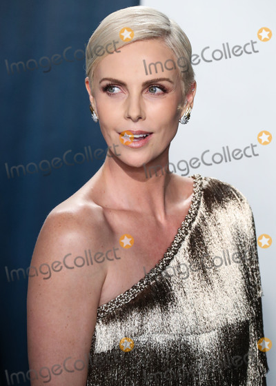 Charlize Theron Photo - BEVERLY HILLS LOS ANGELES CALIFORNIA USA - FEBRUARY 09 Actress Charlize Theron wearing Dior Haute Couture with Jimmy Choo shoes and clutch arrives at the 2020 Vanity Fair Oscar Party held at the Wallis Annenberg Center for the Performing Arts on February 9 2020 in Beverly Hills Los Angeles California United States (Photo by Xavier CollinImage Press Agency)