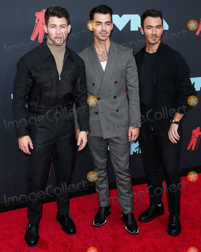 Jonas Brothers Photo - NEWARK NEW JERSEY USA - AUGUST 26 Nick Jonas Joe Jonas and Kevin Jonas of Jonas Brothers arrive at the 2019 MTV Video Music Awards held at the Prudential Center on August 26 2019 in Newark New Jersey United States (Photo by Xavier CollinImage Press Agency)