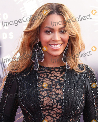 Beyonce Photo - (FILE) Beyonc named musics most powerful woman by BBC Womans Hour power list The superstar came first in a list of the industrys 40 most influential women thanks to her feminism activism and empowering musical messages INGLEWOOD LOS ANGELES CA USA - AUGUST 24 Singer Beyonce wearing a Nicolas Jebran dress Christian Louboutin shoes and Lorraine Schwartz earrings arrives at the 2014 MTV Video Music Awards held at The Forum on August 24 2014 in Inglewood Los Angeles California United States (Photo by Xavier CollinImage Press Agency)
