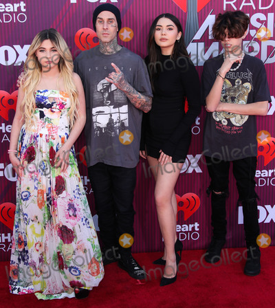 Travis Barker Photo - LOS ANGELES CA USA - MARCH 14 Alabama Barker Travis Barker and Atiana De La Hoya arrive at the 2019 iHeartRadio Music Awards held at Microsoft Theater at LA Live on March 14 2019 in Los Angeles California United States (Photo by Xavier CollinImage Press Agency)