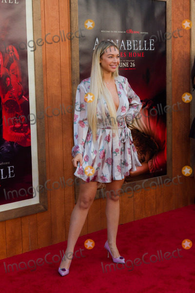 Corinne Olympios Photo - WESTWOOD LOS ANGELES CALIFORNIA USA - JUNE 20 Corinne Olympios arrives at the Los Angeles Premiere Of Warner Bros Annabelle Comes Home held at Regency Village Theatre on June 20 2019 in Westwood Los Angeles California United States (Photo by Rudy TorresImage Press Agency)