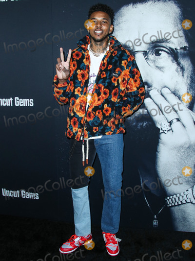 Nick Young Photo - HOLLYWOOD LOS ANGELES CALIFORNIA USA - DECEMBER 11 American basketball player Nick Young arrives at the Los Angeles Premiere Of A24s Uncut Gems held at the ArcLight Cinerama Dome on December 11 2019 in Hollywood Los Angeles California United States (Photo by Xavier CollinImage Press Agency)