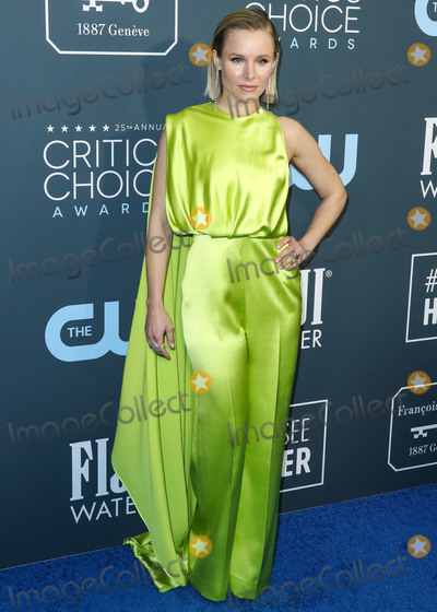 Kristen Bell Photo - SANTA MONICA LOS ANGELES CALIFORNIA USA - JANUARY 12 Actress Kristen Bell wearing a Cong Tri jumpsuit Forevermark jewelry Christian Louboutin clutch and Brian Atwood heels arrives at the 25th Annual Critics Choice Awards held at the Barker Hangar on January 12 2020 in Santa Monica Los Angeles California United States (Photo by Xavier CollinImage Press Agency)