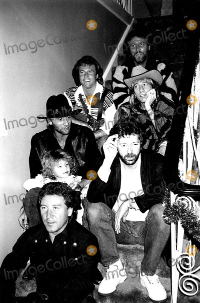 Andy Gibb Photo - The Bee Gees (Top to Bottom) Barry Gibb Andy Gibb Robin Gibb Maurice Gibb and Eric Clapton Renee SchreiberGlobe Photos Inc Mauricegibbretro