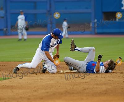 Bryan Cranston Photo - Hollywood Stars Baseball Game at Dodger Stadium in Los Angeles CA Bryan Cranston Safe at Second Photo by Fitzroy Barrett  Globe Photos Inc 8-10-2002 K25794fb (D)