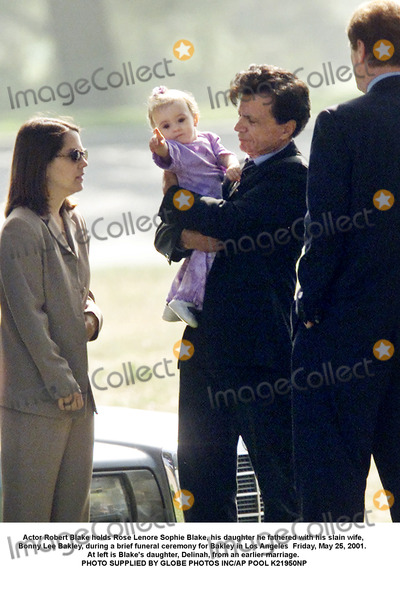 Bonnie Lee Bakley Photo - Actor Robert Blake holds Rose Lenore Sophie Blake his daughter he fathered with his slain wife Bonny Lee Bakley during a brief funeral ceremony for Bakley in Los Angeles  Friday May 25 2001  At left is Blakes daughter Delinah from an earlier marriage PHOTO SUPPLIED BY GLOBE PHOTOS INCAP POOL K21950NP