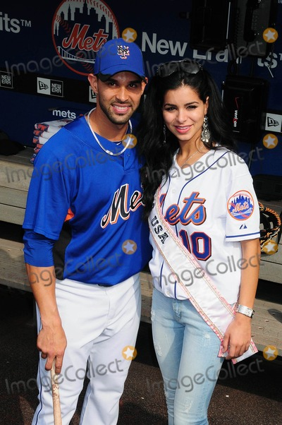 Jose Reyes Photo - Miss USA Rima Fakih Visits Citi Field in New York City 05-27-2010 Photo by Ken Babolcsay-ipol-Globe Photos Inc Rima Fakih with NY Mets Jose Reyes