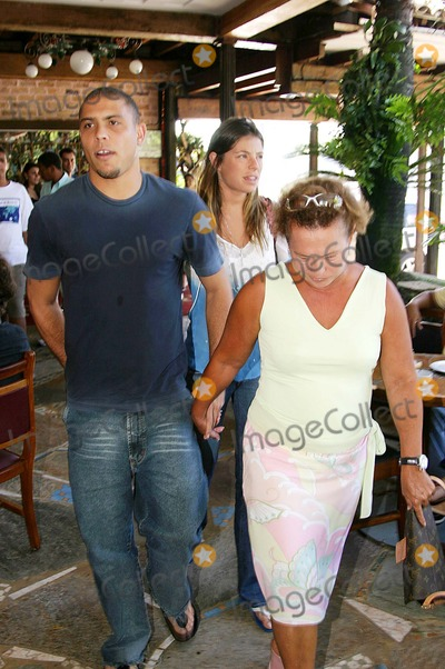 Daniela Cicarelli Photo - EXCLUSIVERIO DE JANEIRO BRAZIL Ronaldo Real Madrid football player and his fiancee Daniela Cicarelli leaving Porcao Restaurant at Rio with his parents Ronaldo and Daniela are in Brazil to resolve some family problems before their wedding next February 14 According to player friends some Ronaldos relatives may have documentation problems to travel to Paris to attends the couple marriage1-30-2005PHOTO BY CLEOMIR TAVARES-CITY FILES-GLOBE PHOTOS INC  2005K41309