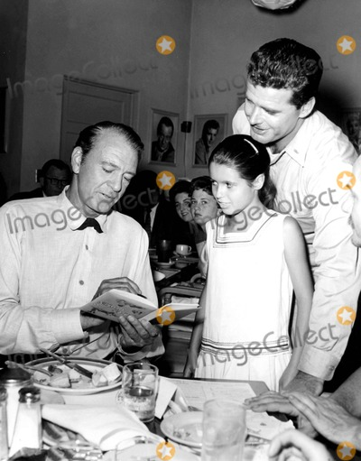 Gary Cooper Photo - Gary Cooper with James Garner and His Daughter Kimberly During Lunch in the Green Room at the Warner Bros Studio 1960s Supplied by SmpGlobe Photos Inc