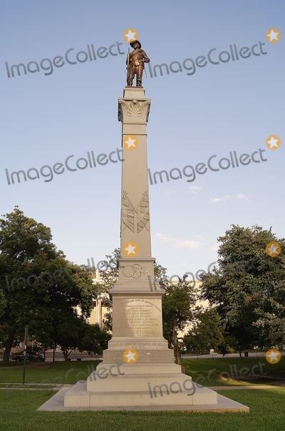 John B Photo - Photo of Hoods Texas Brigade Monument Hoods Texas Brigade Erected 1910 by Surviving Comrades and Friends a Gray Granite Shaft with Hand-carved Quotes by President Jefferson Davis General Robert E Lee and Others Is Topped by the Bronze Figure of a Confederate Soldier the Monument Stands As a Memorial to the Members of John B Hoods Texas Brigade Army of Northern Virginia Principal Battles During Which Some 4000 Soldiers in the Division Died Defending the South Throughout the Civil War Are Listed on the Base the Bronze Figure Was Executed by Pompeo Coppini Photo by Jeff J NewmanGlobe Photos
