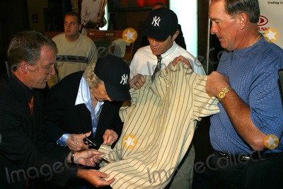 Babe Ruth Photo - Donruss Trading Cards to Unveil Plans For the 1925 Game Worn Babe Ruth Jersey New York City 10202003 Photo by Rick MacklerrangefindersGlobe Photos Inc Babe Ruths Daughter Julia Ruth Stecens Cutting the Jersey
