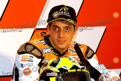 Alex Barros Photo - LISBON PORTUGAL The Moto GP competition press conference Italian Racer Valentino Rossi won Portugal Moto GP Makoto Tamada (Japan) was second and Alex Barros (Brazil) was third In photo Third place at the Moto GP the Brazilian Alex Barros952004PHOTO ALVARO ISIDOROCITYFILESGLOBE PHOTOS INC  2004K39151