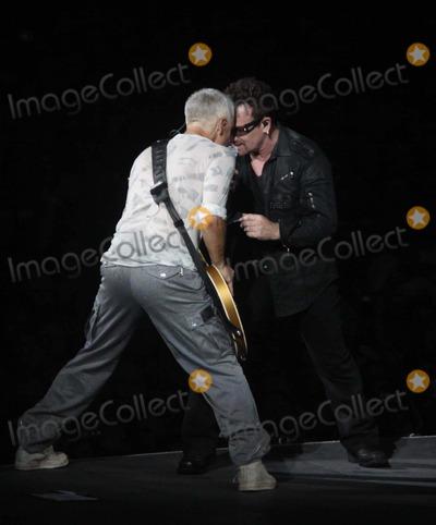 Adam Clayton Photo - Bonoadam Clayton of U2 at U2 Concert at New Meadowlands Stadium NJ 7-20-2011 Photo by John BarrettGlobe Photos Inc