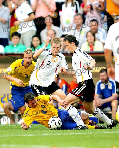 Tobias Linderoth Photo - World Cup Soccer Sweden Vs Germany World Cup Stadium Munich Germany 06-24-2006 Photo Stewart Kendall  Allstar  Globe Photos Inc 2006 Bastian Schweinsteiger Miroslav Klose  Tobias Linderoth