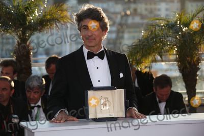 Alexander Payne Photo - Director Alexander Payne Poses with the Award For Best Actor Winner Bruce Dern From Paynes Movie Nebraska at the Winners Photo Call During the 66th Cannes International Film Festival at Palais Des Festivals in Cannes France on 26 May 2013 Photo Alec Michael