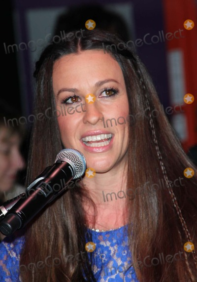 Alanis Morissette Photo - Alanis Morissette Honored on Guitar Centers Rockwalkon 21st August 2012 Held at the Guitar Centerhollywoodcausa Photo TleopoldGlobephotos