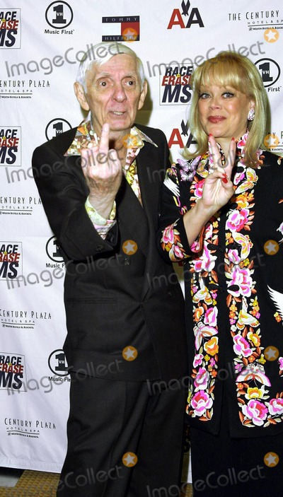 Aaron Spelling Photo - AARON SPELLING AND WIFE CANDY SPELLING9TH ANNUAL RACE TO ERASE MS GALA (THEMED PEACE AND LOVE SEE THE CRAZY FASHION)CO-CHAIRED BY NANCY DAVIS AND TOMMY HILFIGERCENTURY PLAZA HOTEL  SPA CENTURY CITY CAMAY 10 2002PHOTO BY NINA PROMMERGLOBE PHOTOS INC2002 K24942NP