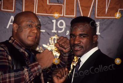 George Foreman Photo - Evander Holyfield with George Foreman Press Conference at Grand Hyatt 1990 L0812 Photo by John Barrett-Globe Photos Inc