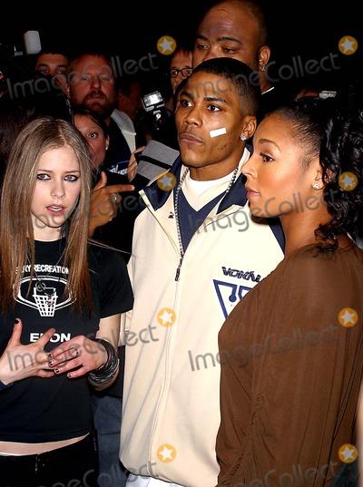 Avril Lavigne Photo - Sd010703 45th Annual Grammy Awards Nominations Announcements at Madison Square Garden NYC Photo by John BarrettGlobe Photosinc 2003 Ashanti and Avril Lavigne and Nelly
