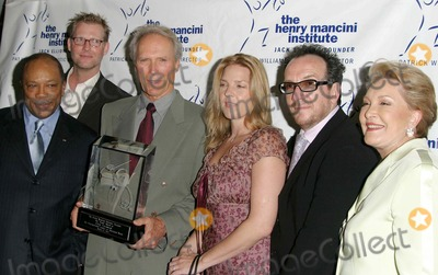 Arturo Sandoval Photo - CLINT EASTWOOD AND QUINCY JONES CRAIG KILBORN CLINT EASTWOOD AND DIANA KRALL ELVIS COSTELLO GINNY MANCINI  -A postage stamp honoring the late composer Henry Manciniwill be unveiled this evening during a Mancini Musicale benefit at UCLAthat will feature a salute to actor Clint Eastwood   Henry Mancinis influence on the music industry has never been strongerand this stamp is a special way to pay tribute to his enduring genius saidPostmaster General John E Potter who along with Quincy Jones will attend thefete   Mancini is the composer of numerous television theme songs and film scoresincluding The Pink Panther He won 20 Grammys and four Oscars and soldmore than 30 million records He died June 14 1994   The stamp -- a painting by Victor Stabin of Mancini conducting -- will be available next Spring   The event at UCLAs Royce Hall will include a cocktail reception and dinner emceed by CBS Late Show talk show host Craig Kilborn A concert featuringDiana Krall Arturo Sandoval and Christian McBride will follow   Clint Eastwood will receive the Hank Award for his support of American music -ROYCE HALL UCLA WESTWOOD CA -08162003 -PHOTO BY NINA PROMMERGLOBE PHOTOS INC2003 K32200NP