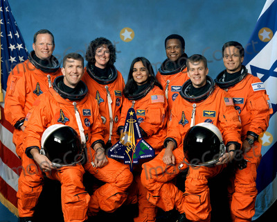 Kalpana Chawla Photo - STS107-S-002 (October 2001) --- The seven STS-107 crew members take a break from their training regimen to pose for the traditional crew portrait Seated in front are astronauts Rick D Husband (left) mission commander Kalpana Chawla mission specialist and William C McCool pilot Standing are (from the left) astronauts David M Brown Laurel B Clark and Michael P Anderson all mission specialists and Ilan Ramon payload specialist representing the Israeli Space Agency SUPPLIED BYNASAGLOBE PHOTOS INCK28788