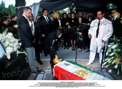 Prince Ali Photo - IMAPRESS PH  CLEMOT  BENITOFUNERAL OF PRINCESS LEILA PAHLAVI IN PARIS 16TH JUNE 2001 IN TOTAL BEREAVEMENT THE EX-EMPRESS OF IRAN FARAH PAHLAVI BURIED HER DAUGHTER IN THE PASSY CEMETERY IN PARIS LEILA PAHLAVI 31 PASSED AWAY A WEEK AGO IN LONDON THE OFFICIAL COMMUNIQUE WRITTEN BY HER MOTHER INDICATED THAT SHE PASSED AWAY IN HER SLEEP BUT THE EXACT CIRCUMSTANCES OF THE DEACEASED REMAIN AS YET UNKNOWNPRINCESS YASMINE PLACES A HEART SHAPED BOX CONTAINING A MESSAGE FROM HER DAUGHTERS NOOR AND IMAN TO THEIR AUNT IN THE BACKGROUND REZA II PRINCE ALI REZA PRINCESS FARAHNAZ EMPRESS FARAH PRINCESS ASHRAF THE SHAHS TWIN SISTER AND TO THE RIGHT OF THE MOLLAH ABDO PAHLAVICREDIT IMAPRESSCLEMOTBENITOGLOBE PHOTOS INC
