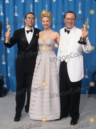 Nicolas Cage Photo - Mira Sorvino with Nicolas Cage and Kevin Spacey at the 68th Annual Academy Awards 1996 Photo by Lisa Rose-Globe Photos Inc