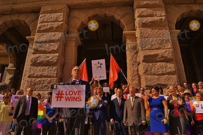 Jim Obergefell Photo - Supreme Court Plaintiff Jim Obergefell Addresses Approximately 150 People Gathered at the North Steps of the Texas State Capitol Building in Austin Texas on 06292015 to Support the Recent United States Supreme Court Ruling on Gay Marriage the Group Was Also Protesting Recent Statements by Texas Governor Gregg Abbott and Ken Paxton Which Said That Marriage Officials in Texas Could Refuse to Perform Gay Marriages If They Had Personal Religious Objections to Homosexual Unionssupreme Court Plaintiff Jim Obergefell Adresses the Crowd and Assembled Mediaphoto by Jeff J Newman Globe Photos