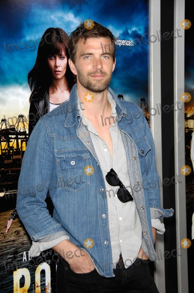 Lucas Bryant Photo - Lucas Bryant During the Premiere of the New Series From Directtv Rogue Held at the Arclight Cinerama Dome on March 26 2013 in Los Angeles Photo Michael Germana  Superstar Images - Globe Photos