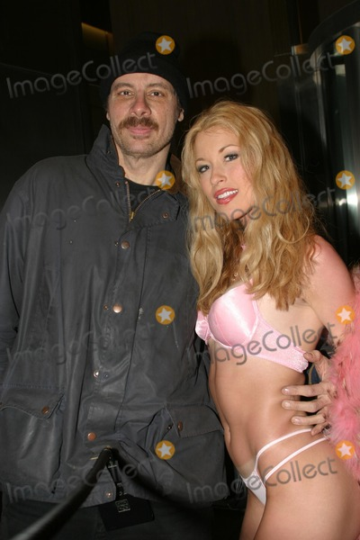 Courtney Taylor Photo - Penthouse Pet of the Year Victoria Zdrok and Runner Up Courtney Taylor Leaving the Howard Stern Show New York City 02132004 Photo by Rick MacklerrangefindersGlobe Photos Courtney Taylor and Famous Celebrity Photographer Rick Mackler
