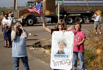 President Ronald Reagan Photo - MOURNERS ALONG THE ROAD -The flag draped casket of former president Ronald Reagan is carried in the hearse for transport to the Naval Base Ventura County at Point Mugu from the Ronald Reagan Presidential Library and then flown to Washington DC for the state funeralMOORPARK CA -06092004 -PHOTO BY POOLGLOBE PHOTOS INC2004K37630NP