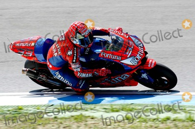 Alex Barros Photo - LISBON PORTUGAL The Moto GP competition race Italian Racer Valentino Rossi won Portugal Moto GP Makoto Tamada (Japan) was second and Alex Barros (Brazil) was third In photo Italian racer Marco Melandri952004PHOTO ALVARO ISIDOROCITYFILESGLOBE PHOTOS INC  2004K39151