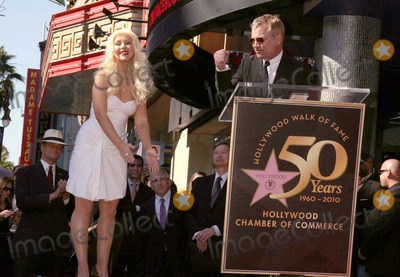 Clint Culpepper Photo - I14795CHW Christina Aguilera Honored With Star On The Hollywood Walk Of Fame Hard Rock Cafe-Front Hollywood CA 11152010  CHRISTINA AGUILERA WITH  CLINT CULPEPPER - PRESIDENT OF SCREEN GEMS Photo Clinton H Wallace-Photomundo-Globe Photos Inc 2010   TONY PARKER AND