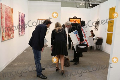 Andy Warhol Photo - The Armory Show 2013 Piers 92 and 94 NYC March 6 2013 Photos by Sonia Moskowitz Globe Photos Inc 2013 Attendees Carrying Brillo Boxes That Were Being Distributed(as in Andy Warhol Brillo Box Artwork)