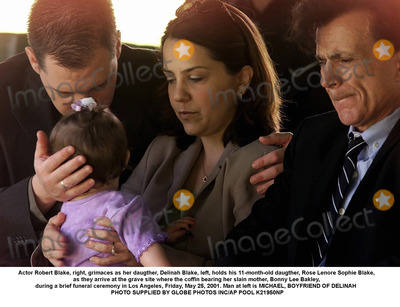 Sophie Blake Photo - Actor Robert Blake right grimaces as her daugther Delina Blake left holds his 11-month-old daugther Rose Lenore Sophie Blake as they arrive at the grave site where the coffin bearing her slain mother Bonny Lee Bakley during a brief funeral ceremony in Los Angeles Friday May 25 2001 Man at left is MICHAEL BOYFRIEND OF DELINAH  PHOTO SUPPLIED BY GLOBE PHOTOS INCAP POOL K21950NP