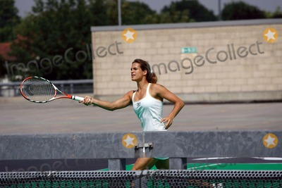 Amelie Mauresmo Photo - K53467Amelie Mauresmo Defending Wimbledon champion begins her warm-up to the Wimbledon championships by taking part in a tennis match on the roof of Brent Cross Shopping Centre Multi-Storey car park London 06-13-2007Photo By Mike Marsland-Spotlight Press-Globe Photos Inc  2007