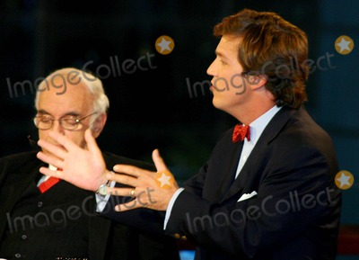 Tucker Carlson Photo - Exclusive K40231wr Taping of  Crossfire  in New York City 1122004 Photo Bywilliam ReganGlobe Photos Inc 2004 Robert Novak and Tucker Carlson