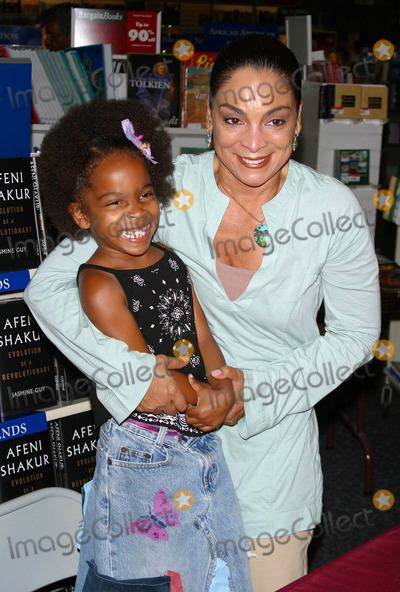 Afeni Shakur Photo - Jasmine Guy Signs Her New Book Afeni Shakur Evolution of a Revolutionary Waldenbooks Baldwin Hills CA (051504) Photo by Milan RybaGlobe Photos Inc2004 Jasmine Guy and Daughter Imani