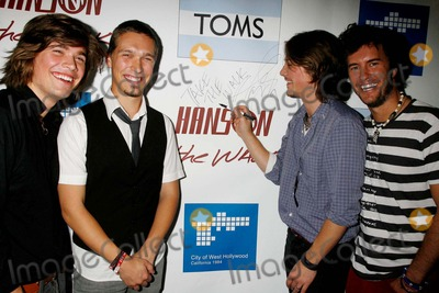 Blake Mycoskie Photo - Hanson and Tom Shoes Join Together to Fight Poverty and Hivaids in Africa City Hall West Hollywood CA 103007 Zac Hanson Isaac Hanson and Taylor Hanson with Blake Mycoskie - Founder of Toms Shoes Photo Clinton H Wallace-photomundo-Globe Photos Inc