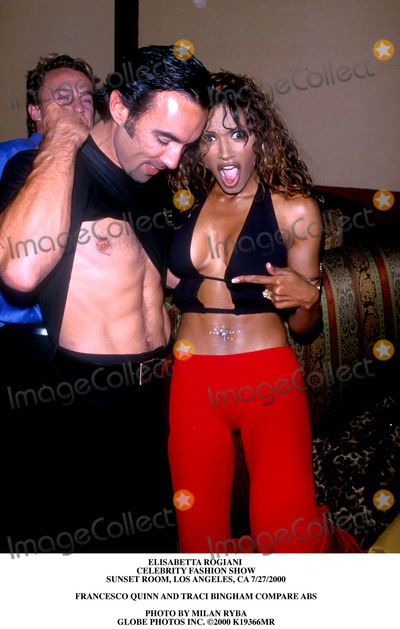 Traci Bingham Photo - Elisabetta Rogiani Celebrity Fashion Show Sunset Room Los Angeles CA 7272000 Francesco Quinn and Traci Bingham Compare Abs Photo by Milan Ryba Globe Photos Inc 2000