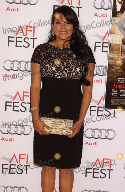 Misty Upham Photo - Misty Upham attends the Screening of August Osage County Screening at the Chinese Theater in Hollywood Ca on November 82013 Photo by Phil Roach-ipoll-Globe Photos