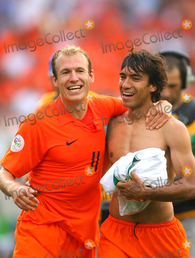 Arjen Robben Photo - Arjen Robben  Van Bronckhorst Cellebrate Win Holland V Ivory Coast World Cup Soccer 06-16-2006 Photo by Allstar-Globe Photos