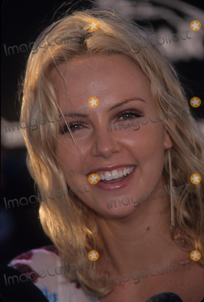 Andy Warhol Photo - Charlize Theron at Gala Opening of Andy Warhol Retro Museum of Contemporary Los Angeles Ca 2002 K25111eg Photo by Ed Geller-Globe Photos Inc