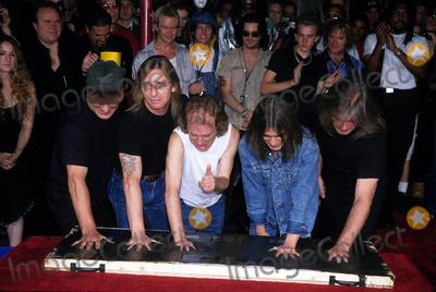 ACDC Photo - Acdc (Brian Johnson Phil Rudd Angus Young Malcolm Young C Williams) Inducted Rockwalk Hollywood CA Photo by Milan Ryba-Globe Photos Inc