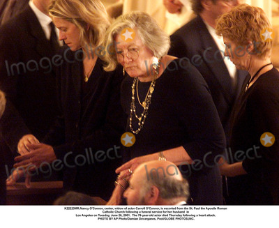 Carroll OConnor Photo - K22223MRNancy OConnor center widow of actor Carroll OConnor is escorted from the St Paul the Apostle Roman Catholic Church following a funeral service for her husband  in Los Angeles on Tuesday June 26 2001  The 76-year-old actor died Thursday following a heart attack PHOTO BY AP PhotoDamian Dovarganes PoolGLOBE PHOTOSINC