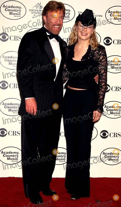 Chuck Norris Photo - Sd0505 34th Annual Academy of Country Music Awards Chuck Norris and Leann Rimes Photo Lisa Rose  Globe Photos Inc 19999 Chucknorrisretro